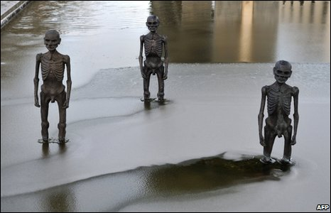 Sculptures stand in water outside the conference venue in Copenhagen, 17 December
