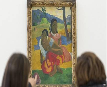 "Two women look at the painting ""Nafea faa ipoipo"" (When will you marry?, 1892) by French painter Paul Gauguin on display in the Fondation Beyeler in Riehen, Switzerland, 06 February 2015"